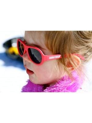 Girl wearing Rockstar Red original Babiators kids sunglasses