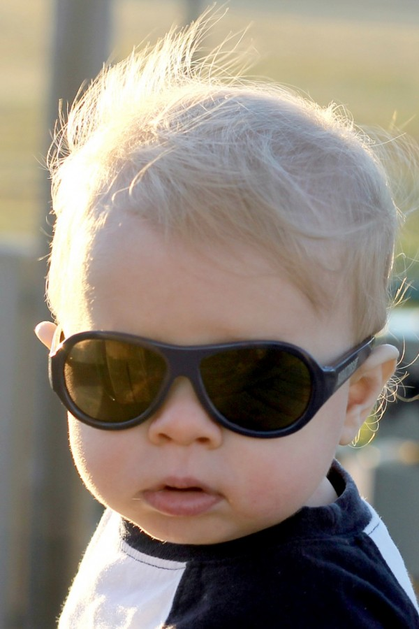 Baby wearing Black Ops Black original Babiators kids sunglasses