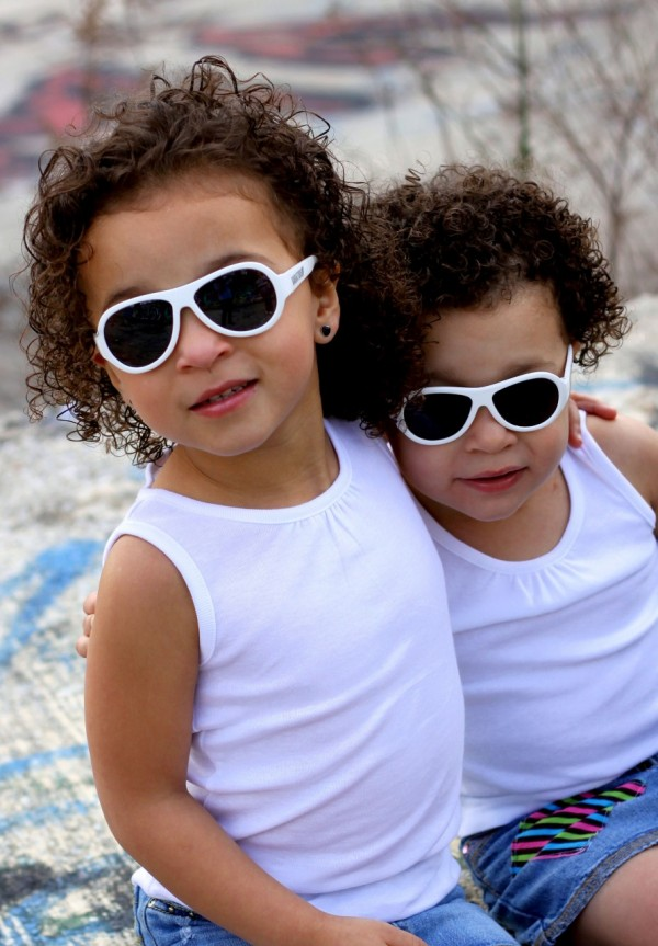 Sisters wearing Wicked White original Babiators kids sunglasses
