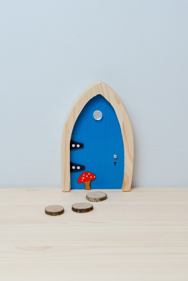 the Irish Fairy Door Company - Blue Arch Fairy Door setup
